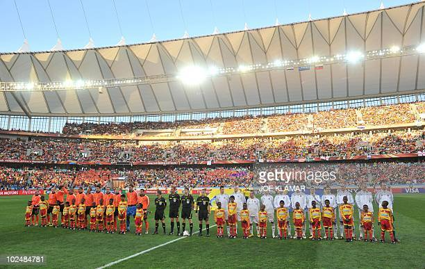 Slovakian players and Netherlands playesr line up to hear their naitonal anthems before the 2010 World Cup round of 16 football match Netherlands...