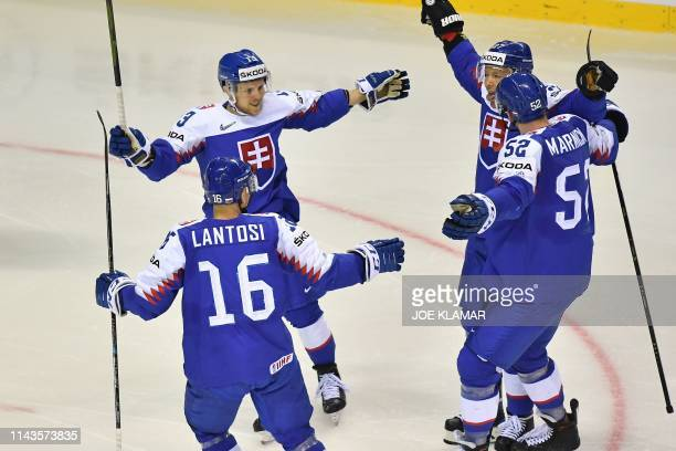 Slovakian players celebrate scoring during the IIHF Men's Ice Hockey World Championships Group A match between Slovakia and Canada on May 13, 2019 in...