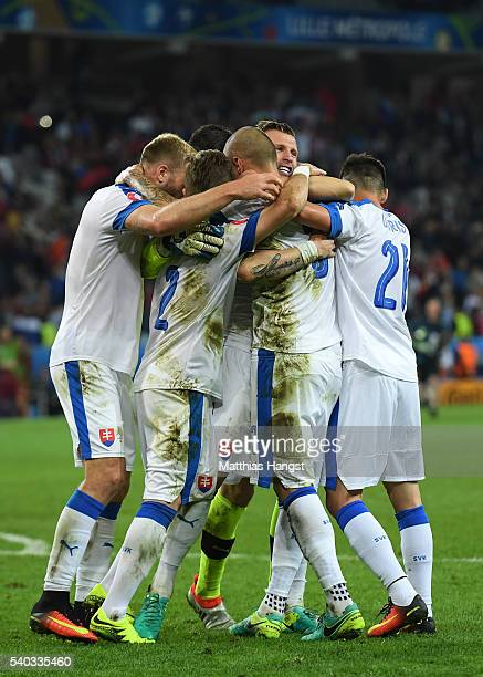 Slovakian players celebrate victory during the UEFA EURO 2016 Group B match between Russia and Slovakia at Stade PierreMauroy on June 15 2016 in...