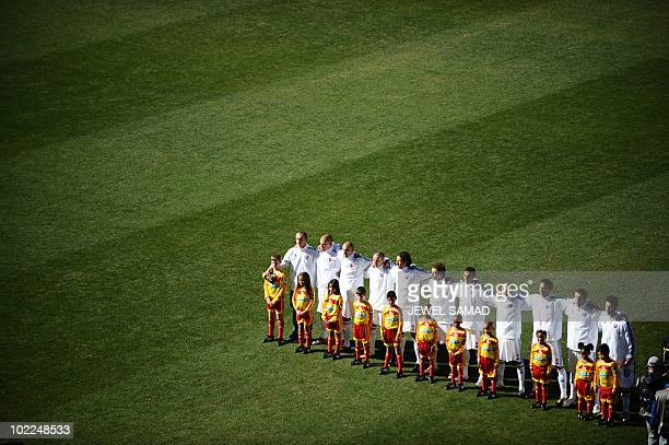 Slovakian players reacts to their national anthem before the start of the Group F first round 2010 World Cup football match between Slovakia and...