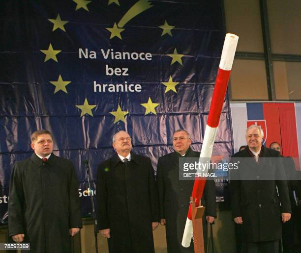 Slovakian Prime Minister Robert Fico Slovakian President Ivan Gasparovic Austrian Chancellor Alfred Gusenbauer and Schengen's Mayor Roger Weber pose...