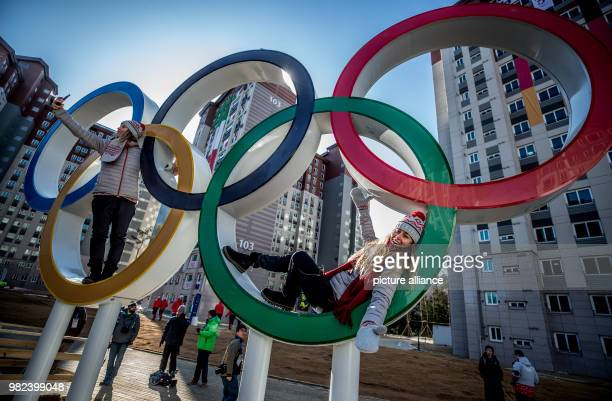 Slovakian snowboarder Chanelle Ruth Sladics lies in the Olympic rings at the Olympic village in Pyeongchang, South Korea, 06 February 2018. Photo:...
