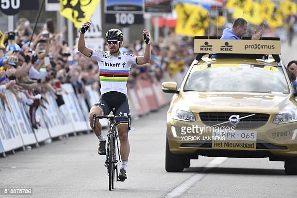Slovakian world champion Peter Sagan crosses the finish line to win the 100th edition of the 'Ronde van Vlaanderen - Tour des Flandres - Tour of...
