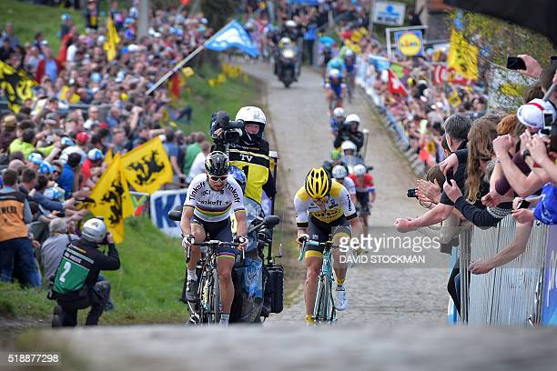 Slovakian world champion Peter Sagan of Tinkoff and Belgian Sep Vanmarcke of Team LottoNLJumbo compete on the Paterberg during the 100th edition of...