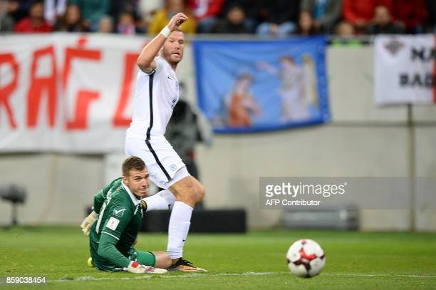 Slovakia's Adam Nemec eyes the ball before scoring despite of Malta's goalkeeper during the FIFA World Cup 2018 qualification football match between...