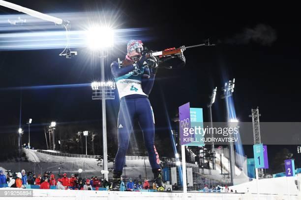 TOPSHOT Slovakia's Anastasiya Kuzmina competes at the shooting range during the women's 125km mass start biathlon event during the Pyeongchang 2018...