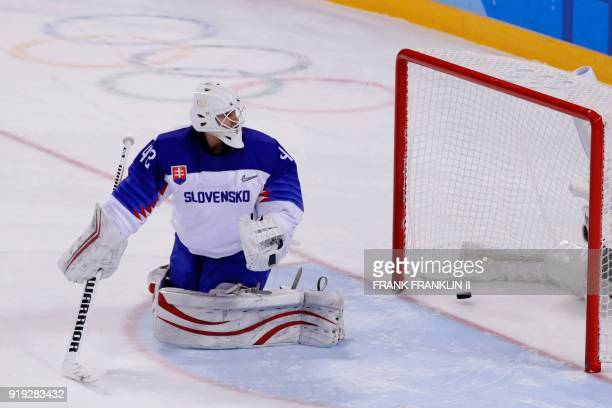 Slovakia's Branislav Konrad reacts after he let in the game winning goal by Slovenia's Ziga Jeglic during the penaltyshot shootout in the men's...