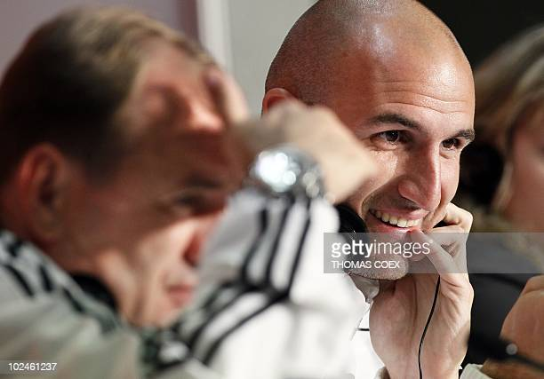 Slovakia's coach Vladimir Weiss and Slovakia's striker Robert Vittek attend a press conference at the Durban stadium on June 27 2010 On June 28...