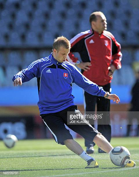 Slovakia's coach Vladimir Weiss looks on as striker Erich Jendrisek kicks the ball during a team training session in Bloemfontein on June 19 2010...