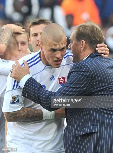 Slovakia's coach Vladimir Weiss speaks to Slovakia's defender Martin Skrtel during their Group F first round 2010 World Cup football match on June 24...