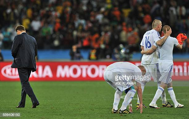 Slovakia's coach Vladimir Weiss walks past his players as they walk off the pitch after losing to Netherlands in their 2010 World Cup round of 16...