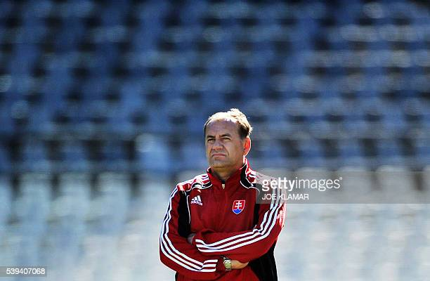 Slovakia's coach Vladimir Weiss watches his players during a team training session in Bloemfontein on June 19 2010 during the 2010 World Cup football...