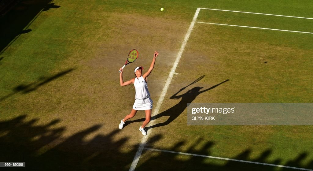 Slovakia's Daniela Hantuchova serves in her doubles match with France's Marion Bartoli on the eighth day of the 2018 Wimbledon Championships at The All England Lawn Tennis Club in Wimbledon, southwest London, on July 10, 2018. (Photo by Glyn KIRK / AFP) / RESTRICTED