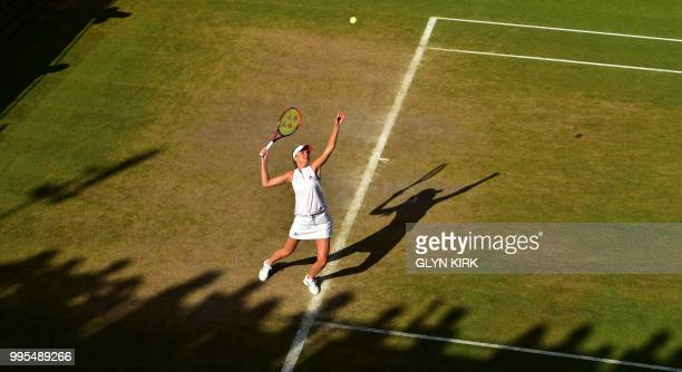 Slovakia's Daniela Hantuchova serves in her doubles match with France's Marion Bartoli on the eighth day of the 2018 Wimbledon Championships at The...