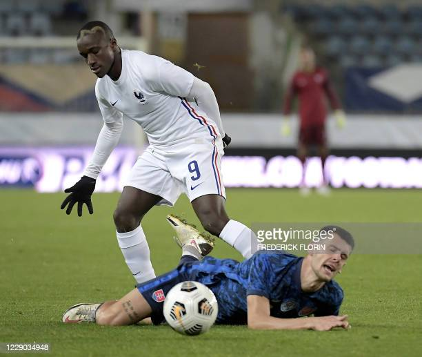 Slovakia's defender Ivan Mesik vies with France's midfielder Moussa Diaby during the U21 European Championships qualification football match France...