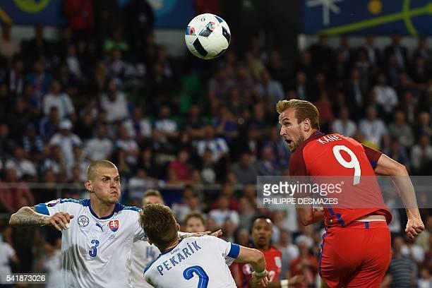 Slovakia's defender Martin Skrtel Slovakia's defender Peter Pekarik and England's forward Harry Kane eye the ball during the Euro 2016 group B...