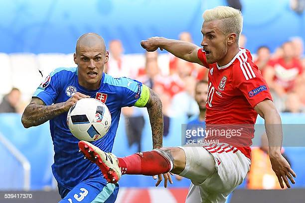 Slovakia's defender Martin Skrtel vies for the ball with Wales' midfielder Aaron Ramsey during the Euro 2016 group B football match between Wales and...