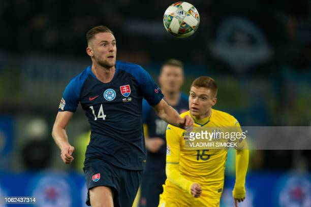 Slovakias defender Milan Skriniar and Ukraines Vitaliy Mykolenko vie for the ball during the UEFA Nations League football match Slovakia v Ukraine in...