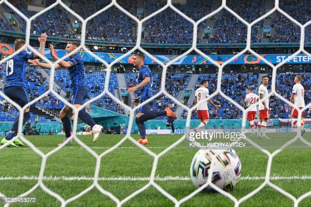 Slovakia's defender Milan Skriniar celebrates with teammates after scoring his team's second goal during the UEFA EURO 2020 Group E football match...