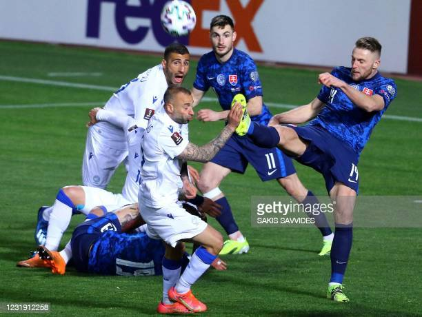 Slovakia's defender Milan Skriniar clears the ball during the 2022 FIFA World Cup qualifier group H football match between Cyprus and Slovakia at the...