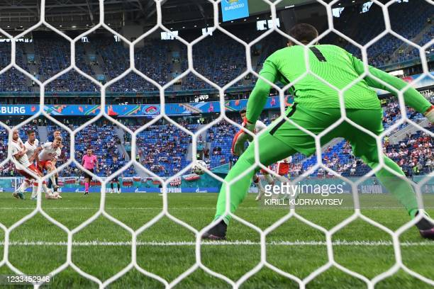 Slovakia's defender Milan Skriniar shoots and scores his team's second goal during the UEFA EURO 2020 Group E football match between Poland and...
