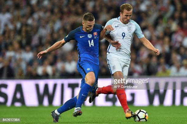 Slovakia's defender Milan Skriniar vies with England's striker Harry Kane during the World Cup 2018 qualification football match between England and...