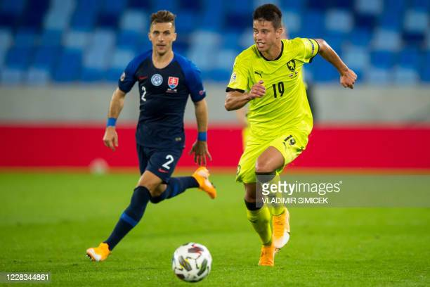 Slovakia's defender Peter Pekarik and Czech Republic's Adam Hlozek vie for the ball during the UEFA Nations League football match between Slovakia...