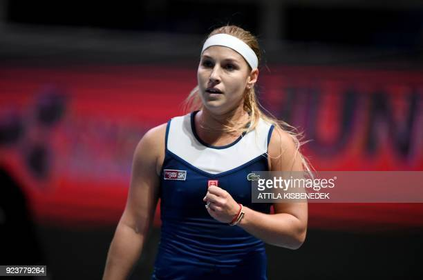 Slovakia's Dominika Cibulkova clenches her fist after marking a point against Germany's Mona Barthel during their semifinal match of the WTA...