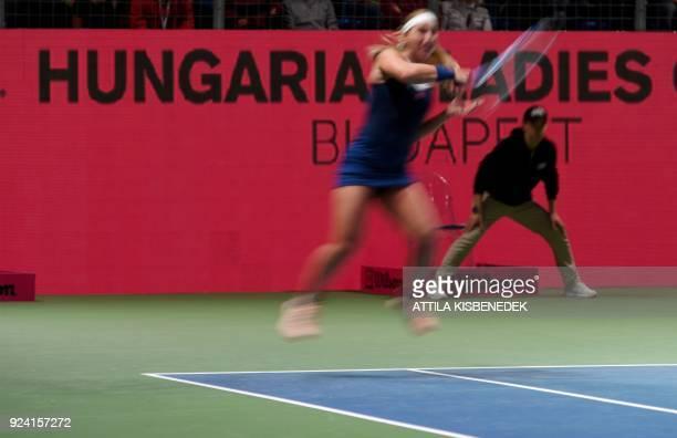 Slovakia's Dominika Cibulkova jumps to return the ball against Belgium's Alison Van Uytvanck during their final match of the WTA Hungarian Open...