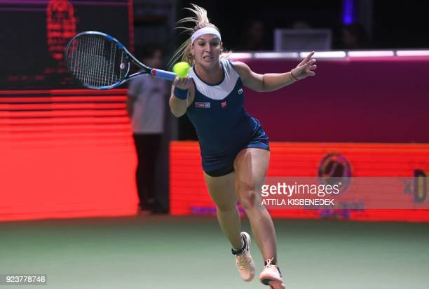 Slovakia's Dominika Cibulkova plays a backhand against Germany's Mona Barthel during their semifinal match of the WTA Hungarian Open Ladies' tennis...