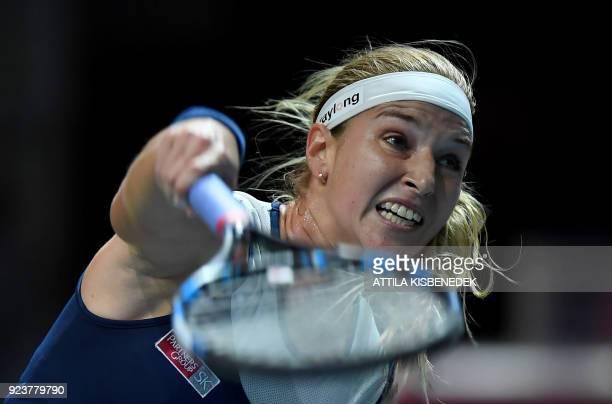 Slovakia's Dominika Cibulkova plays against Germany's Mona Barthel during their semifinal match of the WTA Hungarian Open Ladies' tennis tournament...