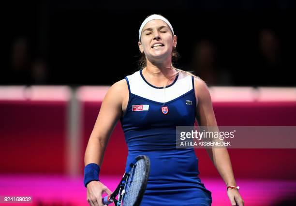 Slovakia's Dominika Cibulkova reacts after she lost her final match of the WTA Hungarian Open Ladies' tennis tournament against Belgium's Alison Van...