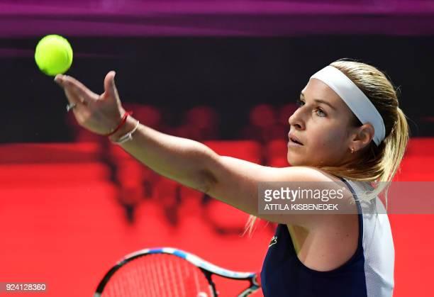 Slovakia's Dominika Cibulkova serves the ball to Belgium's Alison Van Uytvanck during their final match of the WTA Hungarian Open Ladies' tennis...