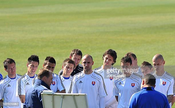 Slovakia's footballers listen to coach Vladimir Weiss during a training session at Caledonian stadium in Pretoria on June 23 2010 during the 2010...