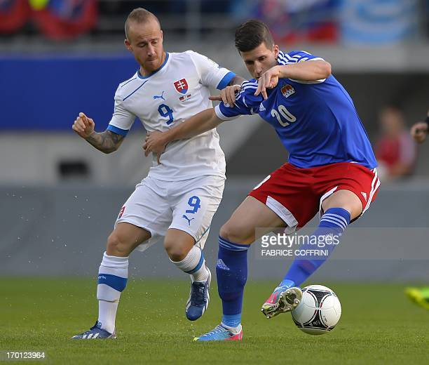 Slovakia's forward Miroslav Stoch and Liechtenstein's Sandro Wieser vie for the ball during their FIFA World Cup 2014 qualifying football match on...