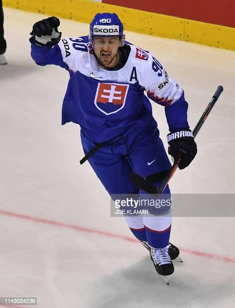 Slovakia's forward Tomas Tatar celebrates scoring during the IIHF Men's Ice Hockey World Championships Group A match between Slovakia and Finland on...