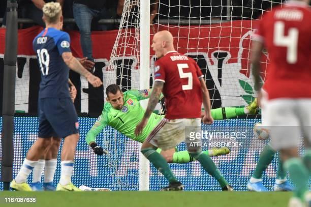 Slovakia's goalkeeper Martin Dubravka fails to save the ball during the UEFA Euro 2020 Group E qualification football match Hungary v Slovakia on...