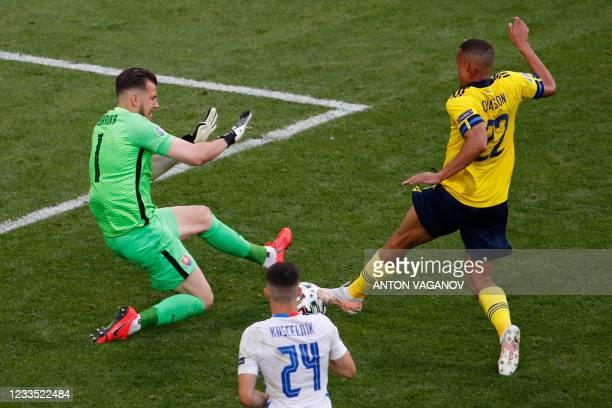 Slovakia's goalkeeper Martin Dubravka fouls Sweden's midfielder Robin Quaison leading to a penalty kick during the UEFA EURO 2020 Group E football...