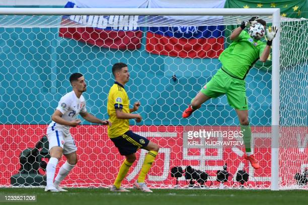 Slovakia's goalkeeper Martin Dubravka stops the ball during the UEFA EURO 2020 Group E football match between Sweden and Slovakia at Saint Petersburg...