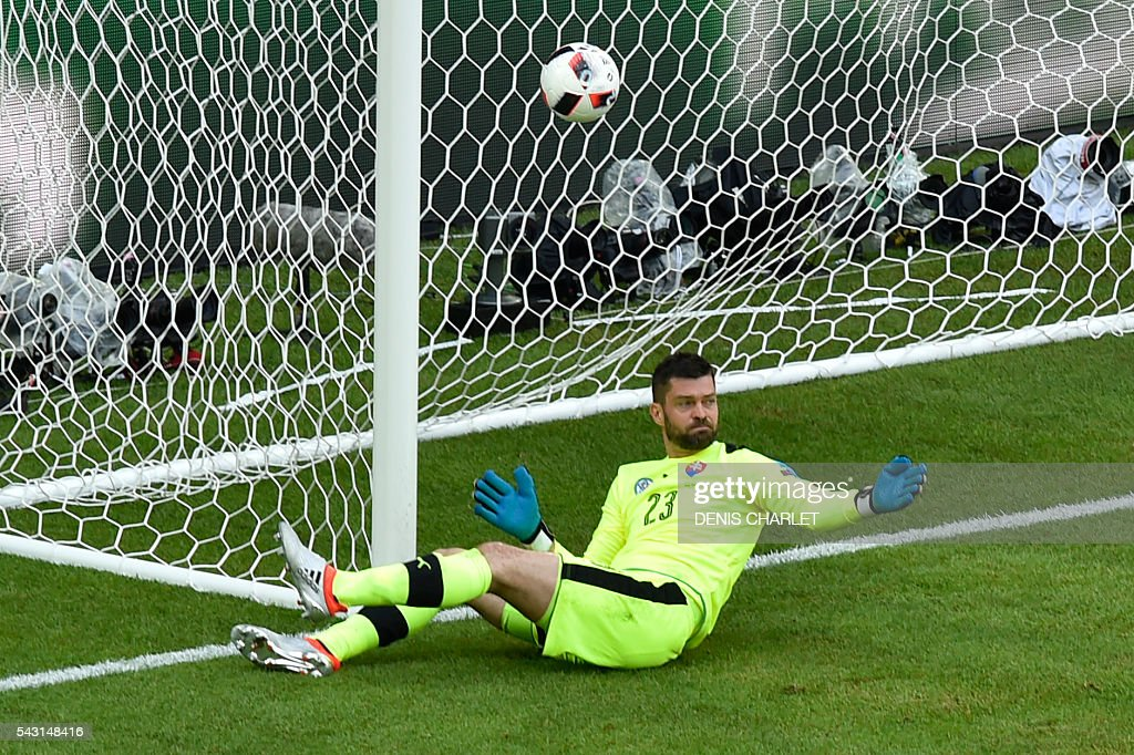 Slovakia's goalkeeper Matus Kozacik fails to stop the ball shoot by Germany's defender Jerome Boateng during the Euro 2016 round of 16 football match between Germany and Slovakia at the Pierre-Mauroy stadium in Villeneuve-d'Ascq, near Lille, on June 26, 2016. / AFP / DENIS