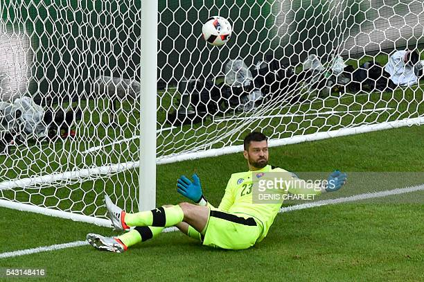 Slovakia's goalkeeper Matus Kozacik fails to stop the ball shoot by Germany's defender Jerome Boateng during the Euro 2016 round of 16 football match...