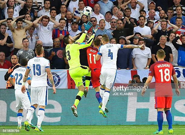 TOPSHOT Slovakia's goalkeeper Matus Kozacik jumps for the ball as he is challenged by England's forward Jamie Vardy during the Euro 2016 group B...