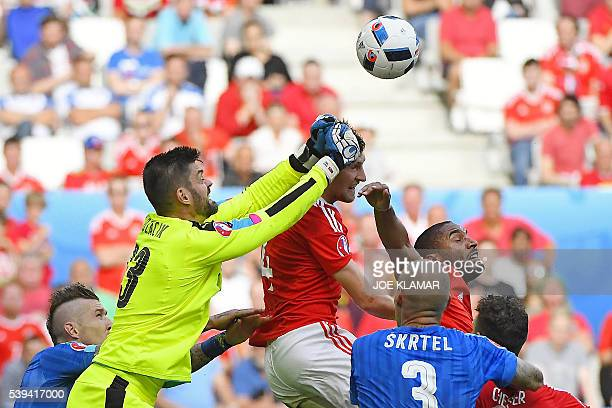 TOPSHOT Slovakia's goalkeeper Matus Kozacik jumps to deflect the ball during the Euro 2016 group B football match between Wales and Slovakia at the...