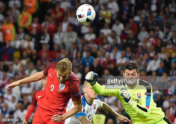 TOPSHOT Slovakia's goalkeeper Matus Kozacik punches the ball clear ahead of England's forward Harry Kane during the Euro 2016 group B football match...