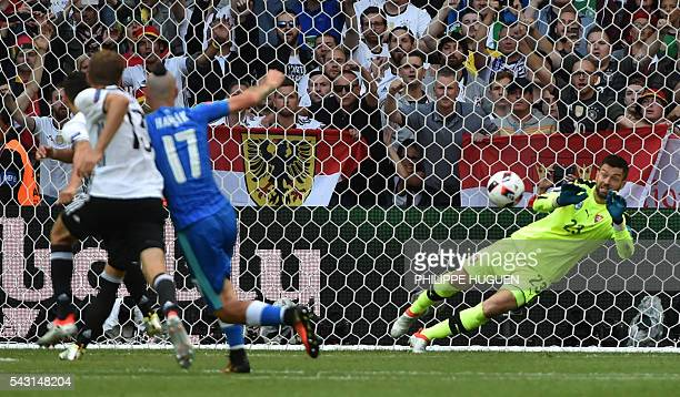 Slovakia's goalkeeper Matus Kozacik saves a penalty during the Euro 2016 round of 16 football match between Germany and Slovakia at the Pierre-Mauroy...