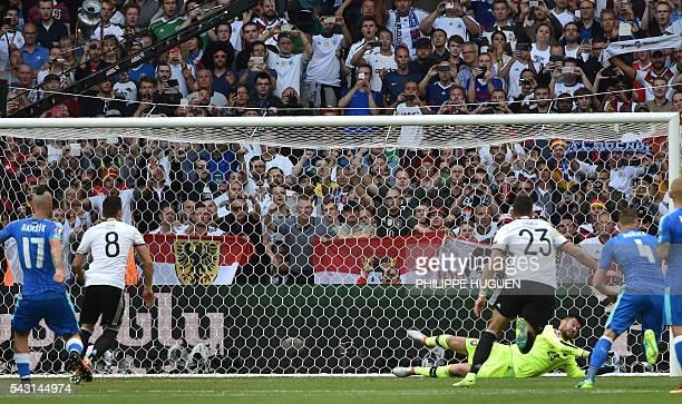 Slovakia's goalkeeper Matus Kozacik saves a penalty shot during the Euro 2016 round of 16 football match between Germany and Slovakia at the...