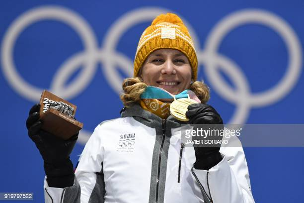 TOPSHOT Slovakia's gold medallist Anastasiya Kuzmina poses on the podium during the medal ceremony for the biathlon women's 125km mass start at the...