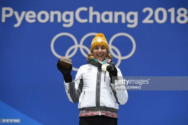 Slovakia's gold medallist Anastasiya Kuzmina poses on the podium during the medal ceremony for the biathlon women's 125km mass start at the...