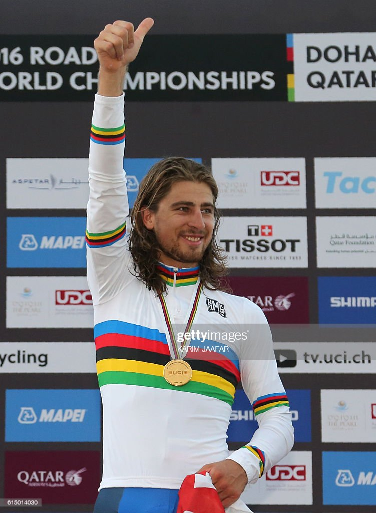 Slovakia's gold medallist Peter Sagan celebrates on the podium at the end of the men's elite road race event as part of the 2016 UCI Road World Championships on October 16, 2016, in the Qatari capital Doha. / AFP / KARIM