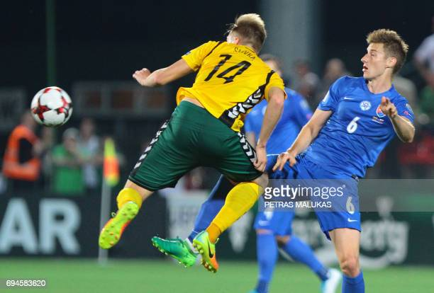 Slovakia's Jan Gregus vies with Lithuania's Vykintas Slivka during the FIFA World Cup 2018 qualification football match between Lithuania and...